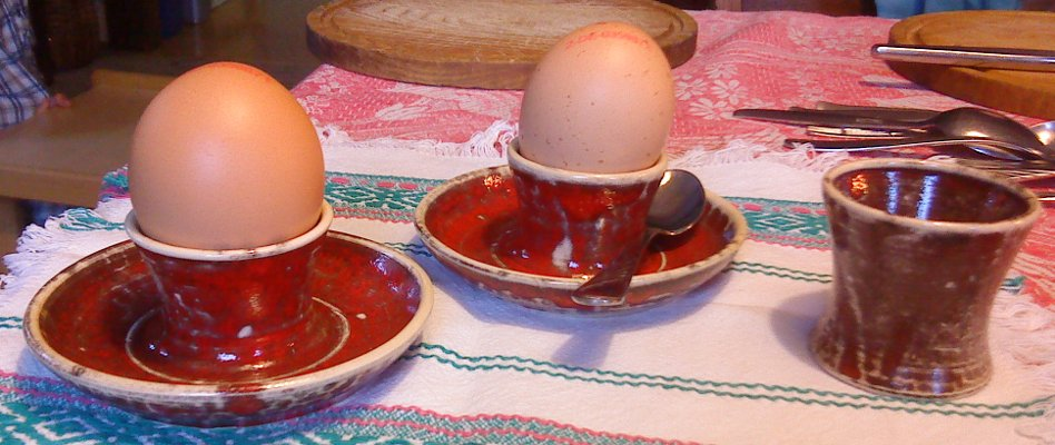 Three egg cups, with saucer and without