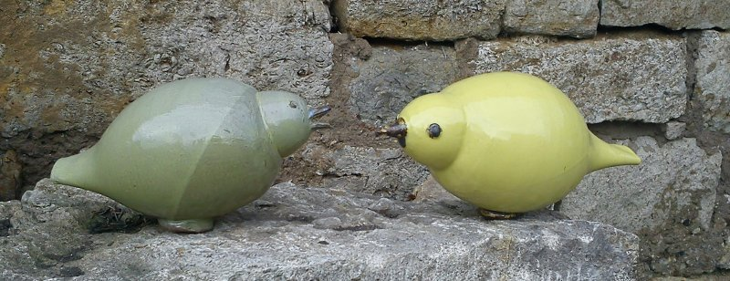 two pottery birds